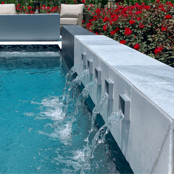 scuppers are a great swimming pool water feature